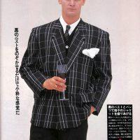 パーティー・ドレッシングの贅沢交響楽:黒のベストとパンツで格子のジャケットを盛りあげる